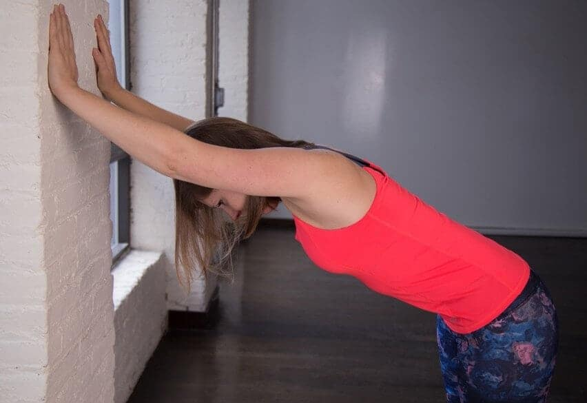 standing wall stretch for shoulder pain while sleeping